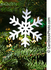 Snow flake shape Christmas ornament in fresh green Christmas...