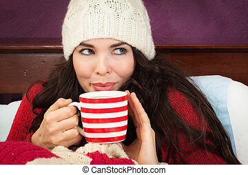 Beautiful woman having hot drink