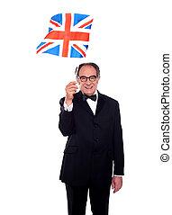Senior UK supporter holding nations flag