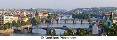 Sunrise over Prague. Panorama of five bridges.