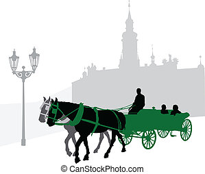 Silhouette of a carriage with tourists in Prague against...