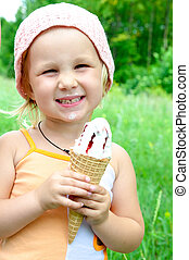 girl eating ice cream - girl holding in their hands and...