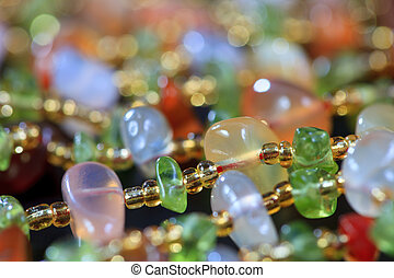 The colored stones in jewelry - The background of colored...