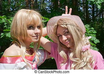 Two young women on nature. Cosplay.
