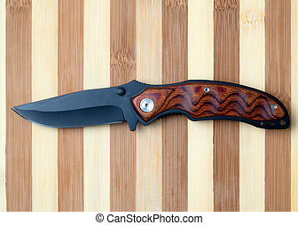 penknife - folding knife with black blade and brown handle