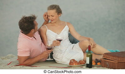 Tender lovers - Lovers flirting on a picnic, young woman...