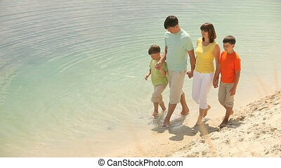 Sunny day, clear water - Family enjoying warm summer day...