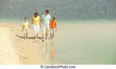 Enjoying life - Cheerful family spending their summer day...