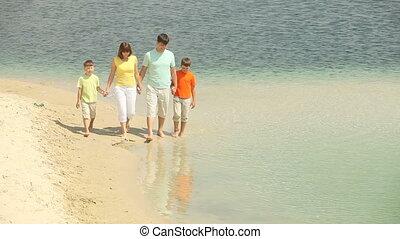 Enjoying life - Cheerful family spending their summer day...