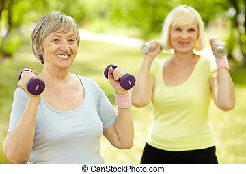 Fitness outdoors - Healthy senior ladies keeping fit...