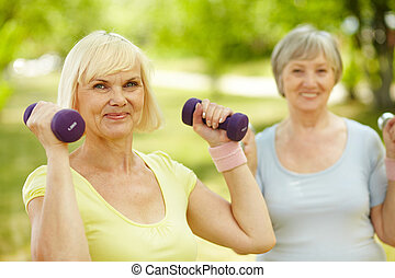 Living healthy lifestyle - Mature females enjoying...