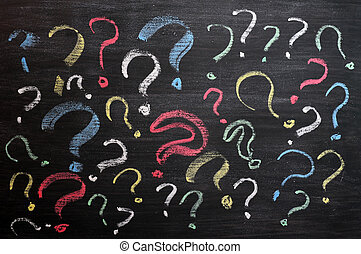 Question marks on chalkboard. Decision, confusion, FAQ or...