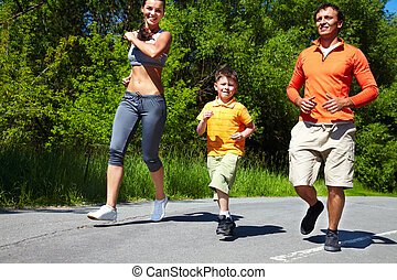 Joggers - Family jogging in the open air enjoying summer...