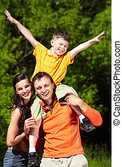 Fun outdoors - Young family of three spending a happy day...