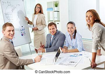 At seminar - Image of confident partners looking at camera...