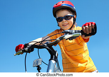 Active youth - Cheerful little guy in protective sportswear...