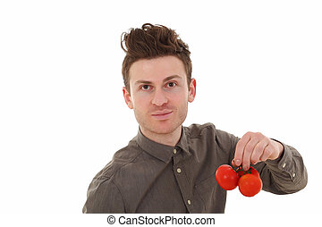 Portrait of young man holding tomatoes