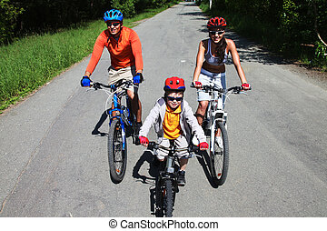 Keeping fit - Three cyclists participating in a ride to form...