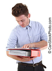 Young man checking documents