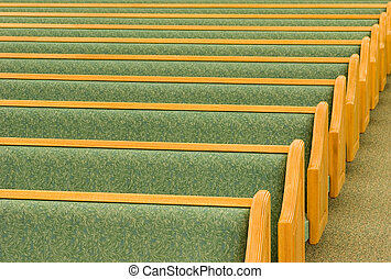 Empty Church Pews - Many rows of empty church pews.