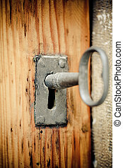 Key - The old rusty key is sitting in the door eye.
