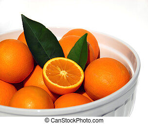 fresh picked oranges in bowl