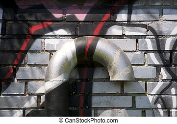 Ventilation with graffiti - An air duct aginst a wall, all...
