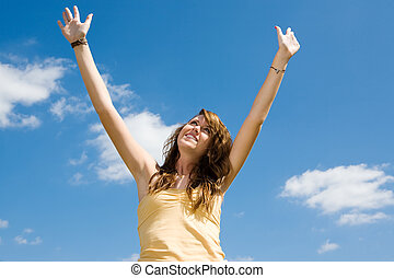 Teen Girl Praise - Beautiful teen girl raising her arms and...