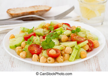vegetable salad with chick-pea on the plate