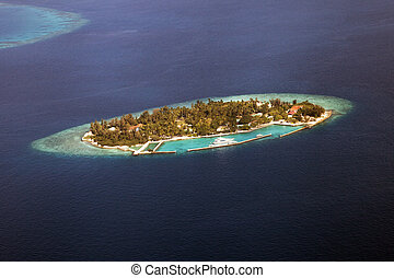 Atoll in the Maldives - Aerial shot of an atoll in the...