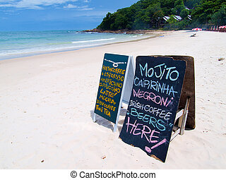 blackboard coffee menu on the beach
