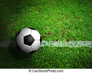 Football soccer ball in green grass field