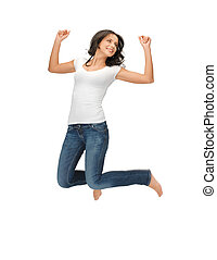 jumping woman in blank white t-shirt - bright picture of...
