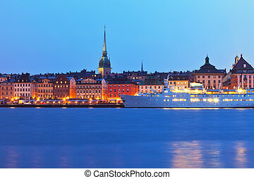Beautiful evening scenery of the Old Town (Gamla Stan) pier...