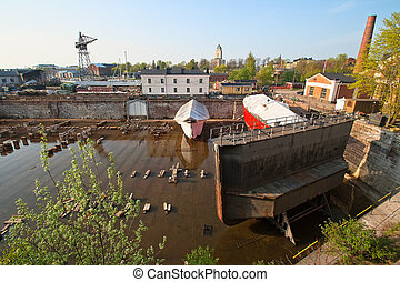 Dry dock - Ship docking without water standing on ships