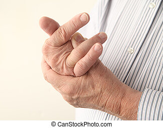 aching fingers - a man with pain in his fingers