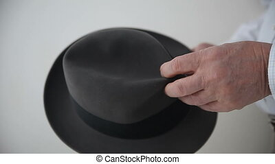 man with old felt hat - a man checks out his vintage hat