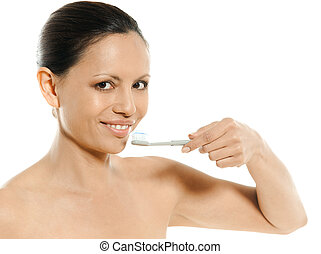 Closeup portrait of cute Asian woman with toothbrush in...
