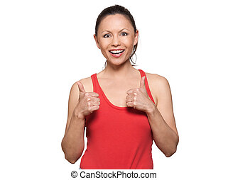 Portrait of cute happy woman showing thumbs up - Portrait of...