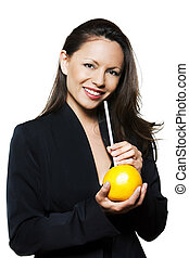 Portrait of beautiful woman holding orange and straw -...