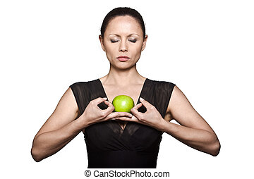 Beautiful Asian woman with green apple meditating - Portrait...