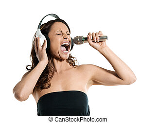Portrait of a beautiful mature woman singing into microphone...