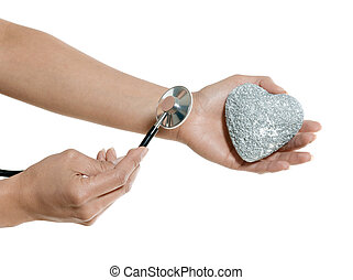 Closeup of hands examining heart of stone in studio isolated...