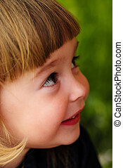 Little girl feel shy - Little girls face with hands and...