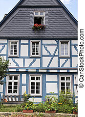Blue half-timbered house