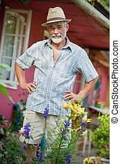 Senior man in the garden - Portrait of a senior man in the...