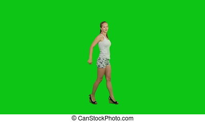 Summer girl dancing - A beautiful girl dances in shorts and...