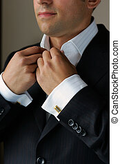 Getting dressed for work - Businessman getting dressed for...