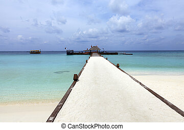 Resort dock - Path leading to docking area for boats and sea...