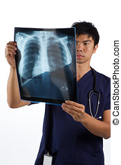 Asian Male nurse looking at an X-ray - Asian healthcare...